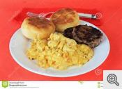Scrambled eggs sausage and biscuits